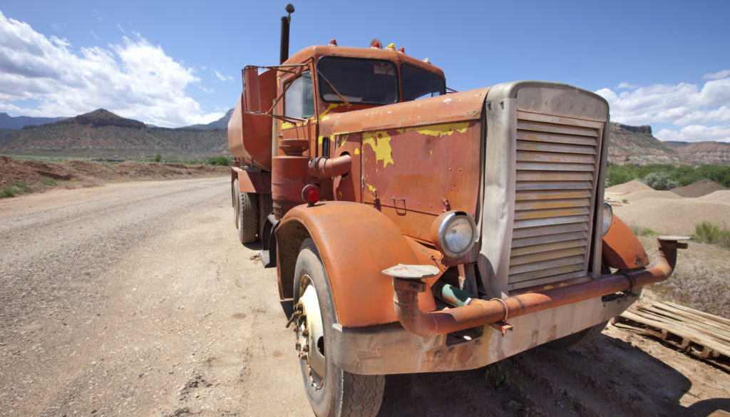 Big Vintage Orange Truck In The Desert