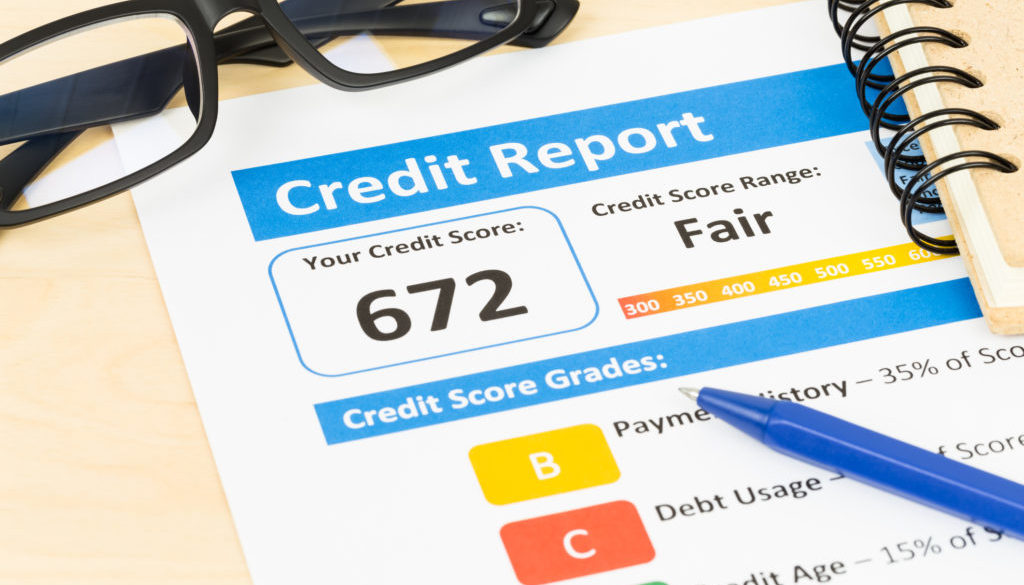 Fair credit score report with pen