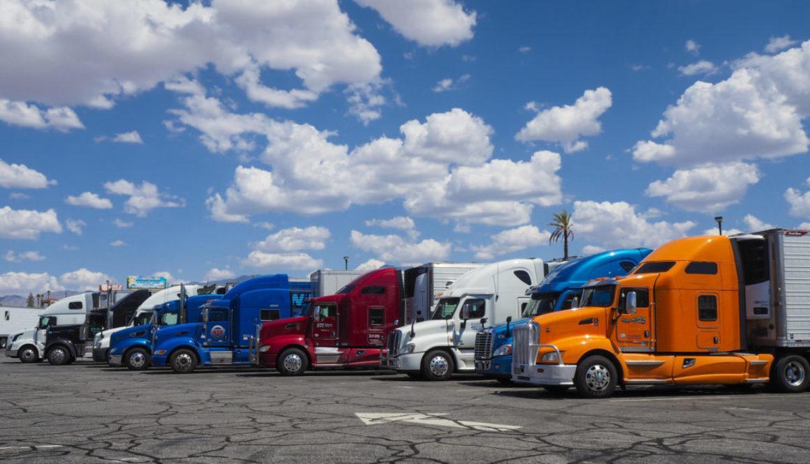 Trucking Industry Trends of 2019 - Semi Trucks in a Row