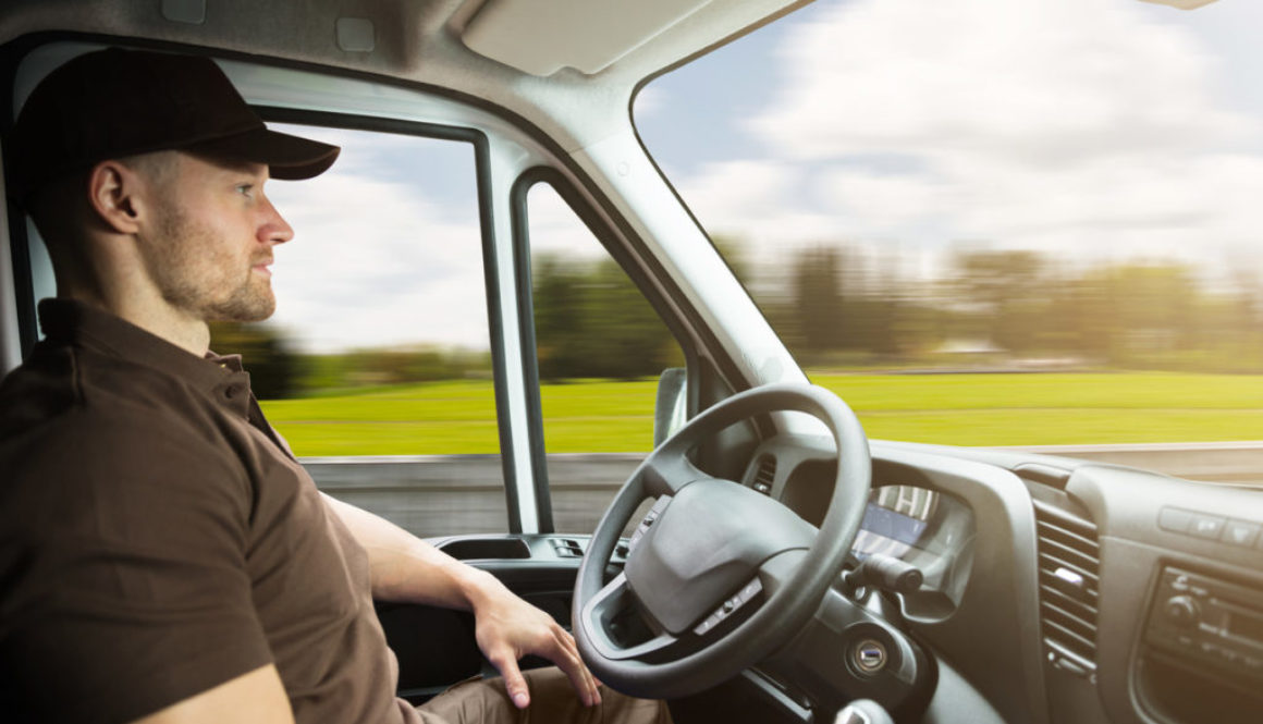 Portrait Of A Delivery Man Inside Self Driving Van