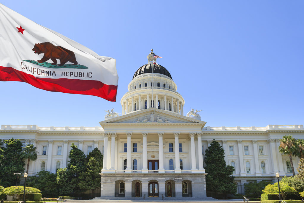 California state flag flying in front of capital building