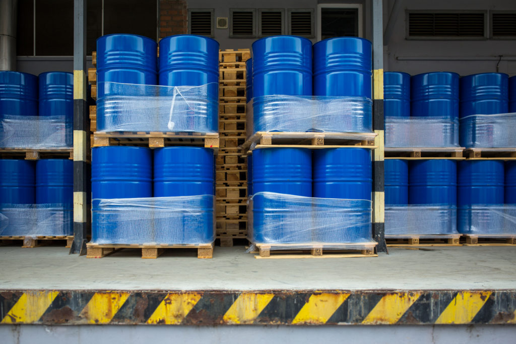 Toxic waste/chemicals stored in barrels at a plant